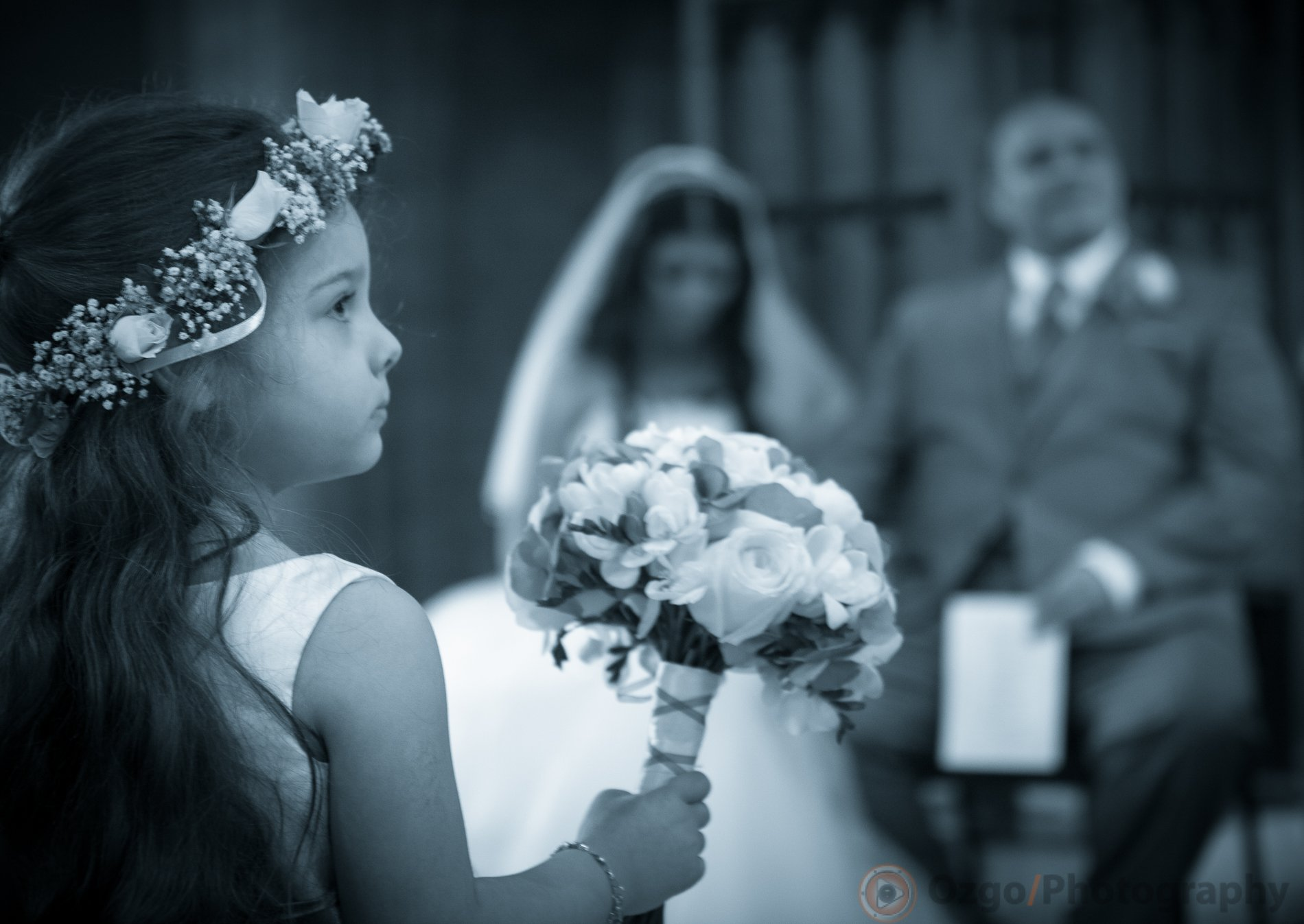 Ozgo Wedding Photography - Flower girl holding a bouquet during ceremony
