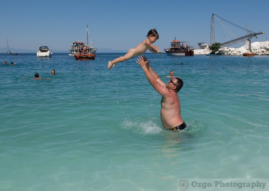 throwing a baby in the air