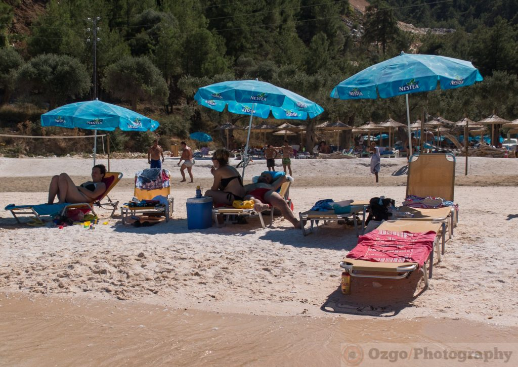 blue umbrellas on the beach, Porto Vathy, Marble Beach, Thassos, Greece