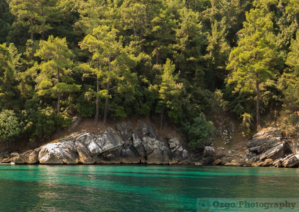 Emerald water and rocky shore in Thassos