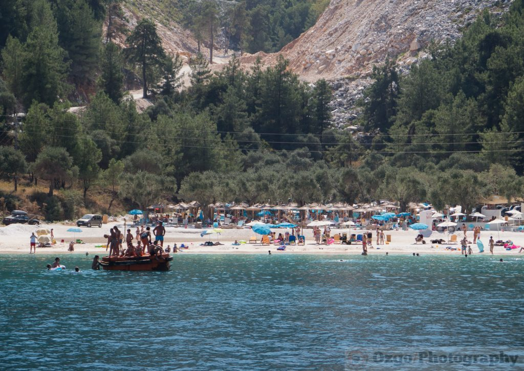 People on the beach in Porto Vathy, Marble Beach, Thassos