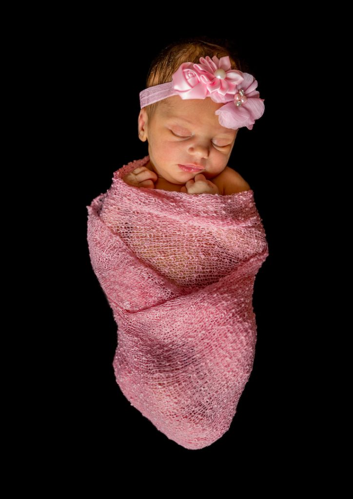 Highly commended image - Bundle of Joy, newborn baby wrapped in pink fabric